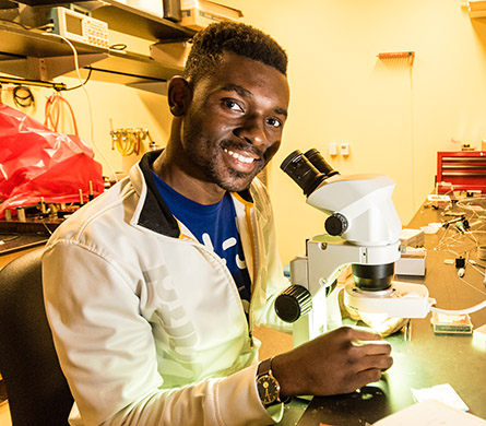 Current Undergraduate Students - Student at microscope