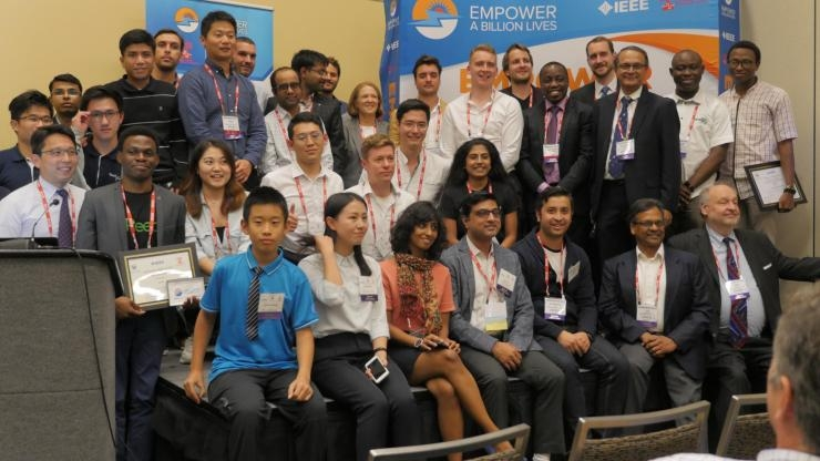 Team participants with event sponsors at Empower a Billion Lives