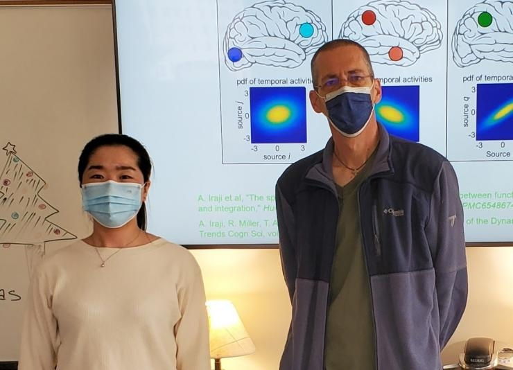 Researchers Kuaikuai Duan and Vince Calhoun have found that neurological complications of Covid-19 patients may be linked to lower gray matter volume in the front region of the brain even six months after hospital discharge. (Photo credit: Calhoun)